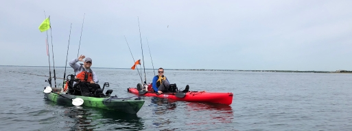 Brian Hall and Eric Amberson searching for fish at the 2018 Yak Attack