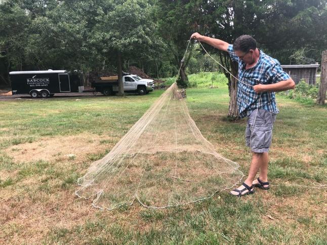 Steve Babcock hauls in a full net